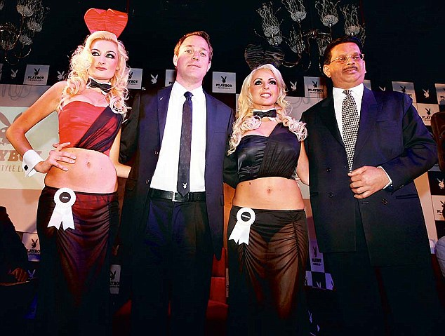 Playboy bunnies with Playboy executive president Mathew Nordby and Sanjay Gupta, right, chief executive, PB lifestyle