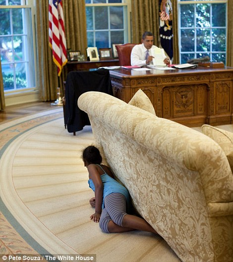 Sasha crawls into the Oval Office and spies on her father by hiding behind the sofa. When she reached the far end, she jumped up and yelled, trying to spook him