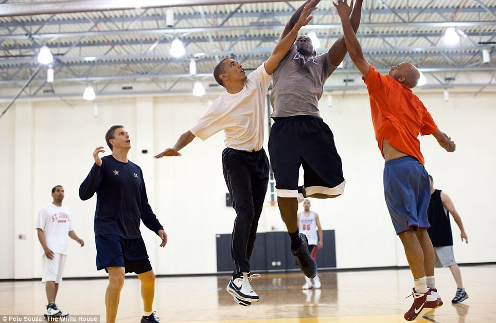 President Obama tries to block a layup shot by his former personal aide, Reggie Love, at Fort McNair in Washington, D.C.