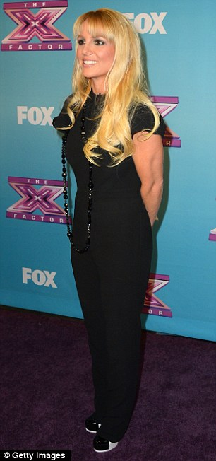 Back to black: Both judges Demi and Britney donned surprisingly low-key black outfits for the big finale