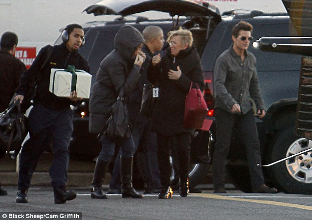 Entourage: Tom was accompanied by a large crew, but later left them all behind as he jetted off his in his helicopter