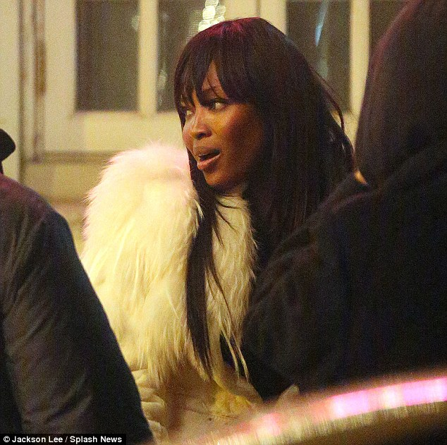 Festive: Naomi looked perfect for winter in her white fur coat