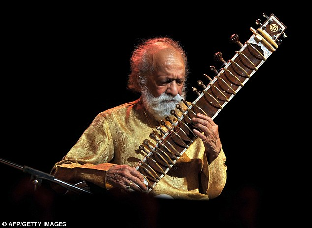 Renowned: Indian Sitar maestro, Pandit Ravi Shankar plays during the Premaanjali Festival 2012, a musical concert held at the Palace Grounds in Bangalore on February 7