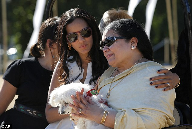 Together: Rajan, right, is comforted by daughter Anoushka