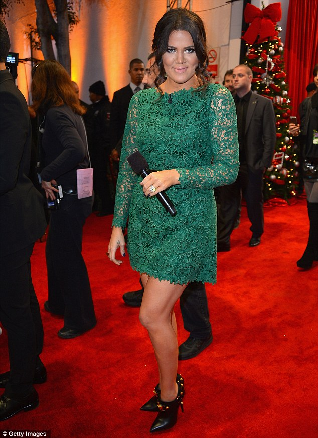 Green with envy: Khloe Kardashian on the red carpet of The X Factor final in Los Angeles pn Thursday wearing the first of three dresses she chose for the show