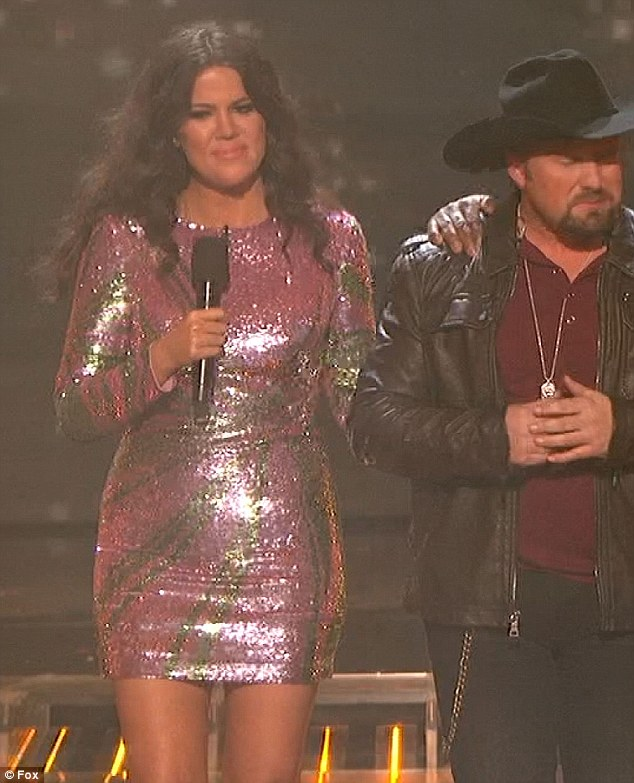 Times three: For the final part of the show Khloe opted for a glittery pink and green number