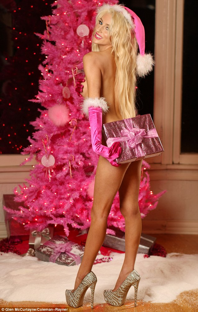 Festive and flirty: The 18-year-old stood stark naked in front of a bright pink tinsel tree