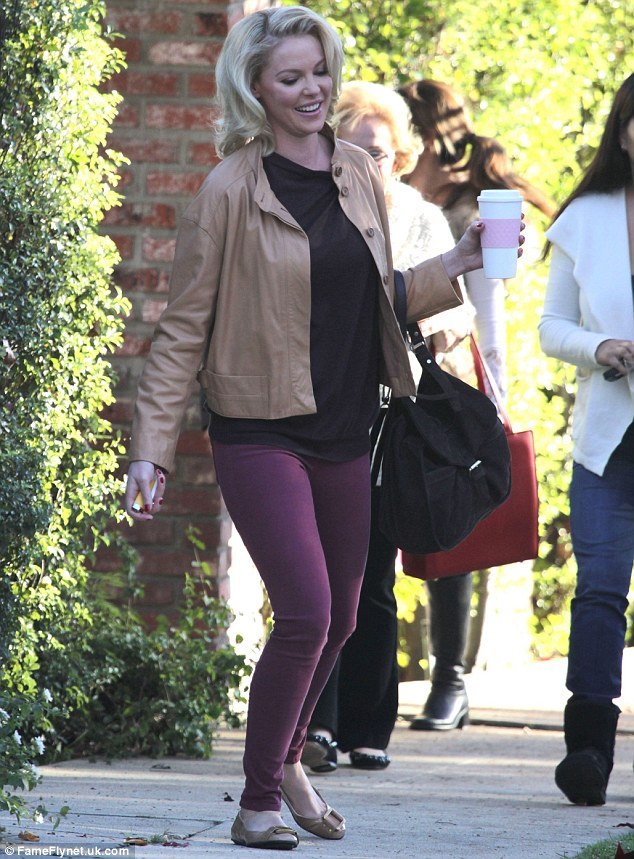 Effortlessly chic: The star looked stylish in a pair of plum-coloured jeans, a loose-fitting black T-shirt, tan leather jacket and matching ballet pumps