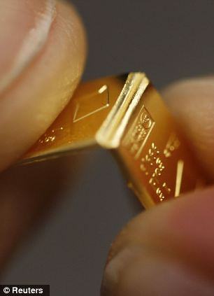 Gold chocolate bar: An employee divides a gold Combibar at a plant of gold refiner and bar manufacturer Valcambi in the southern Swiss town of Balern. Sales have soared amid economic uncertainty in Europe