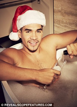 Lounging around: Louis is also pictured in the bath and rocking a Christmas jumper too