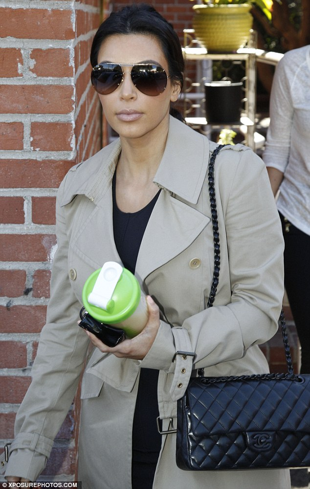 A shake for Kim: The reality star carried along a health shake as she continues to battle with her curves