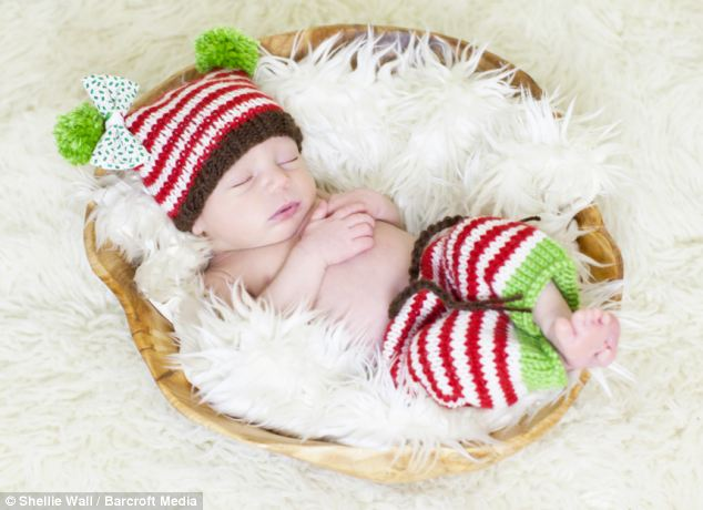 Bundle of joy: This tiny tot sleeps in a basket with a bobble hat and leg warmers on