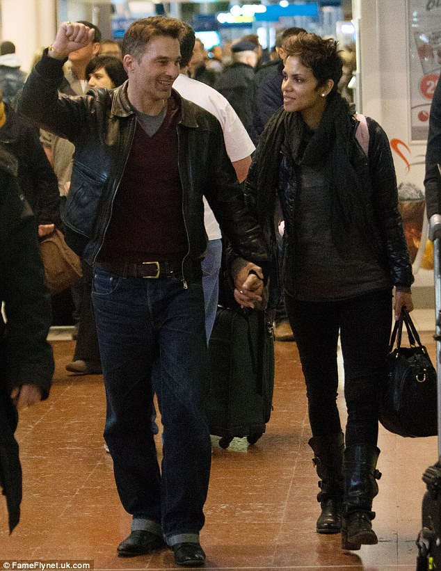 Vive la France! Olivier seemed triumphant as the couple walked through the arrivals terminal
