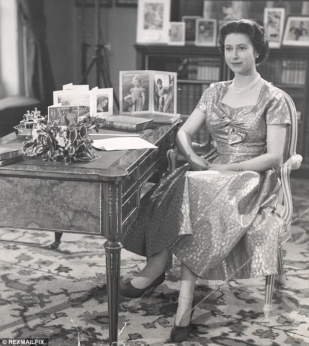 Historic: The Queen is pictured in the Long Library at Sandringham House following her first televised Christmas Day message in 1957