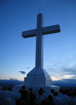 A shrine in Medjugorje marks the spot on the top of the hill where the visionaries claim to see the Virgin Mary