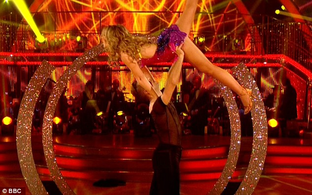 Giving her all: Kimberley and her partner Pasha Kovalev performed a series of daring lifts