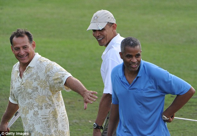 Bobby Titcomb (left) puts out his hand fronting U.S. President Barack Obama (centre) and Marty Nesbitt (right) during a round of gold in 2010