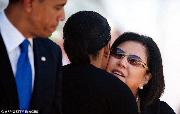 Embrace: First Lady Michelle Obama hugs Irene Hirano Inouye at the memorial