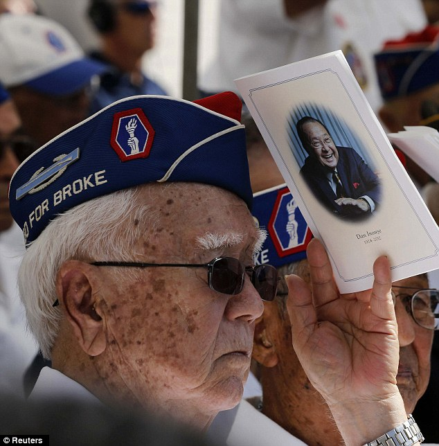 Band of brothers: A World War II veteran of the U.S. Army's 442nd Regimental Combat Team honors his fellow soldier, the late U.S. Senator Daniel Inouye