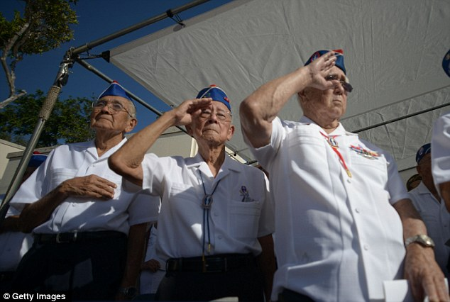 Brothers at arms: World War II veterans from the 442nd Combat Regimental Team salute during the funeral services for their late comrade