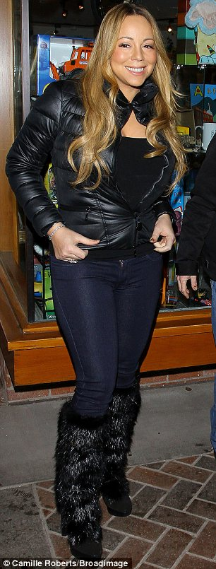Snow bunny: Mariah teamed her too-small jacket with a black top and skinny jeans tucked into furry black moon boots