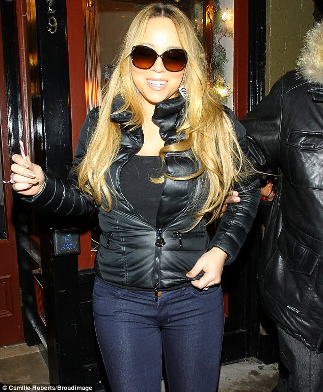 Always a diva: Even though it was dark outside Mariah still opted to wear sunglasses