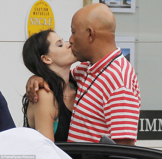 So good to see you! Russell Simmons greeted German girlfriend Hana Nitsche with a passionate kiss as she joined him on vacation in St. Barts