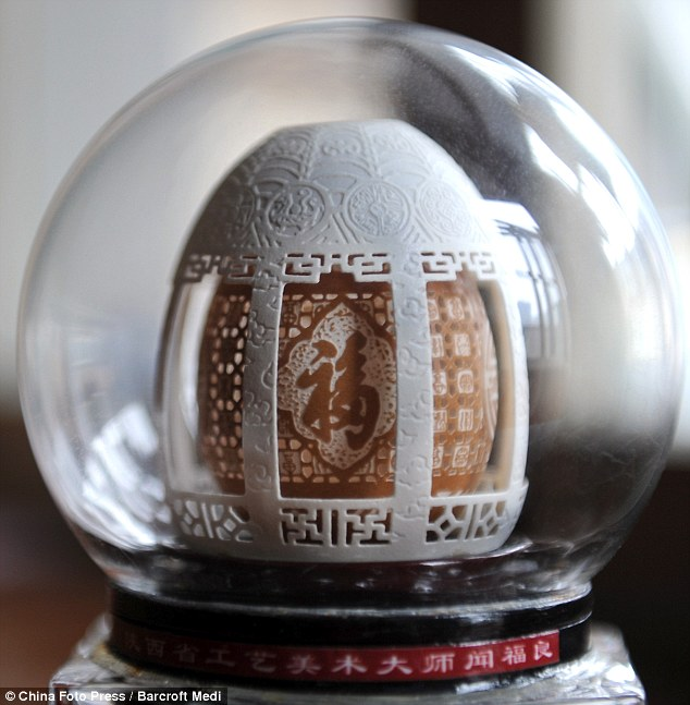 Artistry: This sculpture contains a brown egg shell within a white egg shell