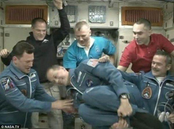Small crew of astronauts celebrate Merry Christmas on