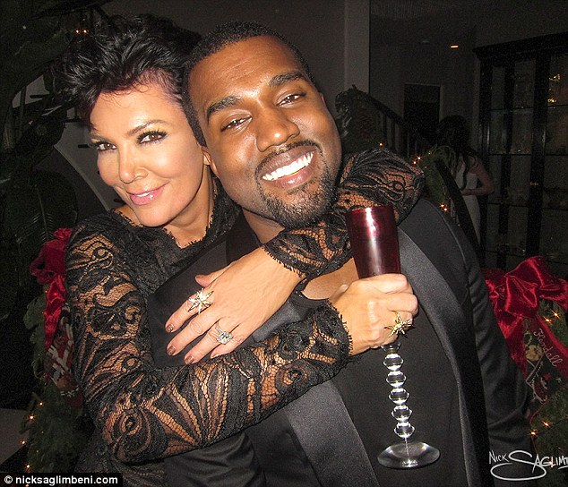 Cracking a rare smile! Rapper Kanye West gets affectionately embraced by his girlfriend Kim Kardashian's mother, Kris Jenner, at her annual Christmas Eve bash