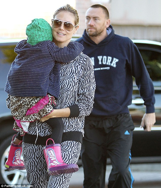Hear them roar: Earlier that morning, Heidi dressed herself and her daughter Lou in leopard spots and zebra stripes for a casual Starbucks pit-stop in Brentwood