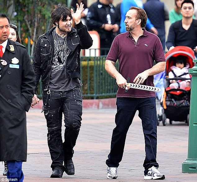 Father-son bonding: Weston and Nicolas seemed to be getting along famously as they wandered around Disneyland in Anaheim, California, together on Thursday