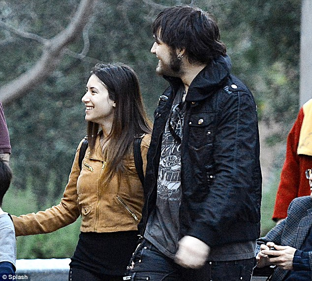 Happy times: Weston seemed to be holding hands with a pretty brunette as they wandered around the park together