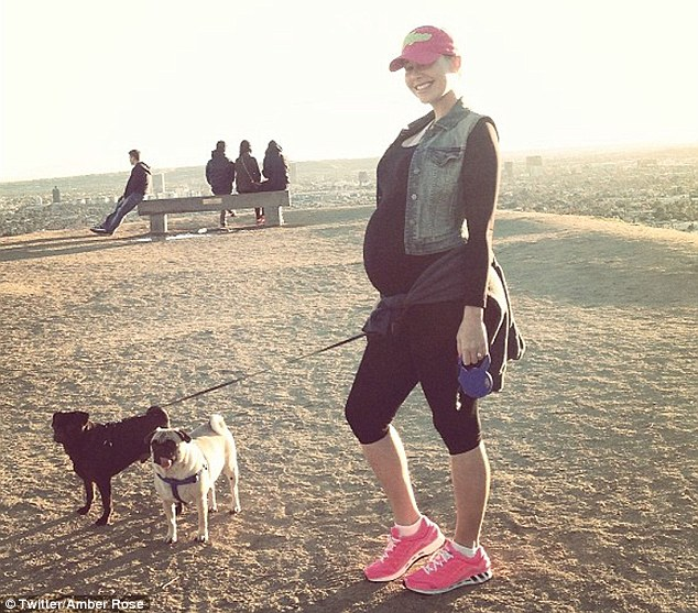 Workout chic: Amber Rose enjoyed a hike up Runyon Canyon in Los Angeles on Thursday with her two pet dogs
