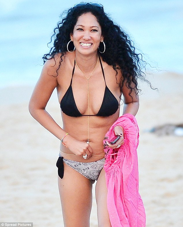 345b8d6fe6c Belly laughs: Kimora Lee Simmons could not stop smiling as she enjoyed a  day on the beach in St Barts on ...