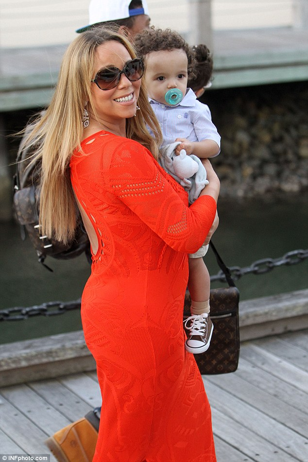 Carried away: Mariah proudly hoisted little Moroccan up in her arms to show him off