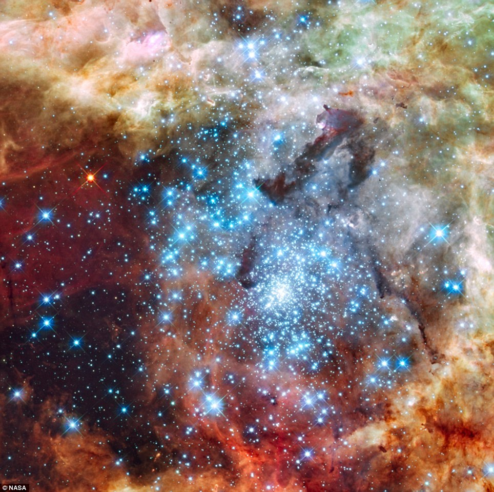Clusters: Astronomers have caught two clusters full of massive stars that may be in the early stages of merging. The clusters are 170,000 light-years away in the Large Magellanic Cloud, a small satellite galaxy to our Milky Way