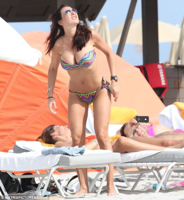 Sun-filled: Miss Minetti looked carefree as she enjoyed the beach despite the allegations against her