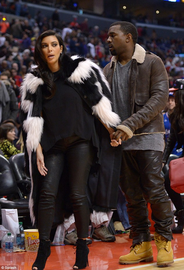 Expecting: Kim Kardashian and Kanye West attend the NBA game between the Denver Nuggets and the Los Angeles Clippers at Staples Center on Christmas Day