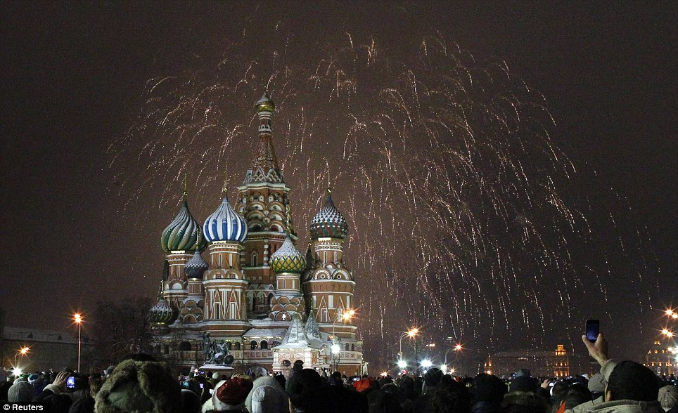 Beautiful: Fireworks explode over St. Basil Cathedral in Moscow's Red Square