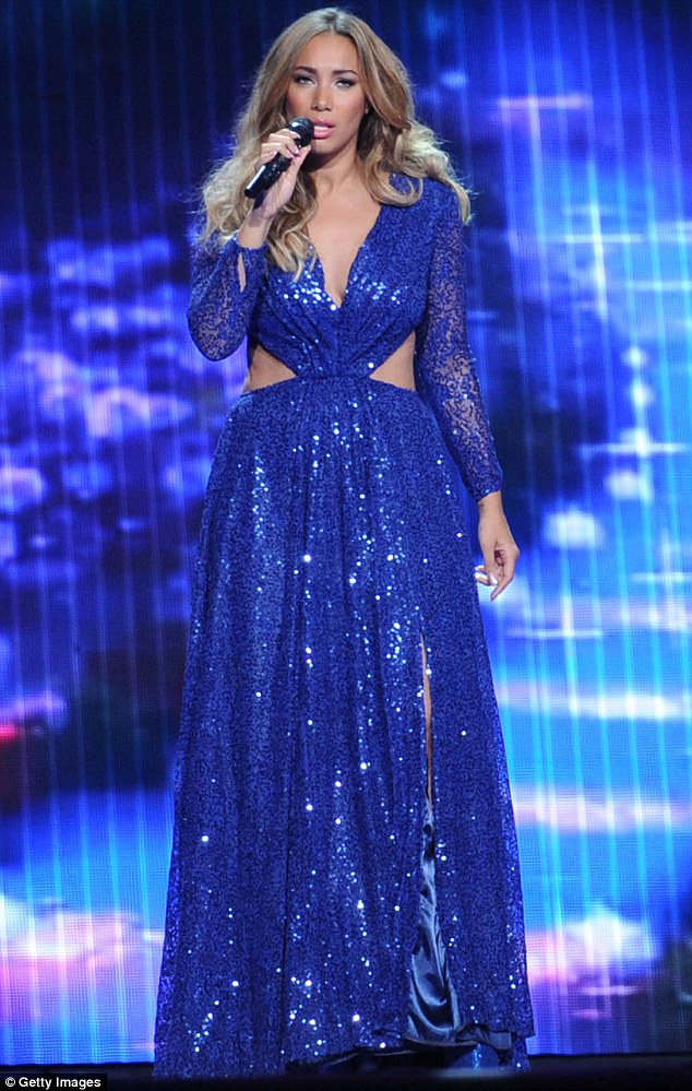 Creating an illusion: Leona Lewis wore a dress that made her slim figure look bigger than it actually is during a performance in China on Monday