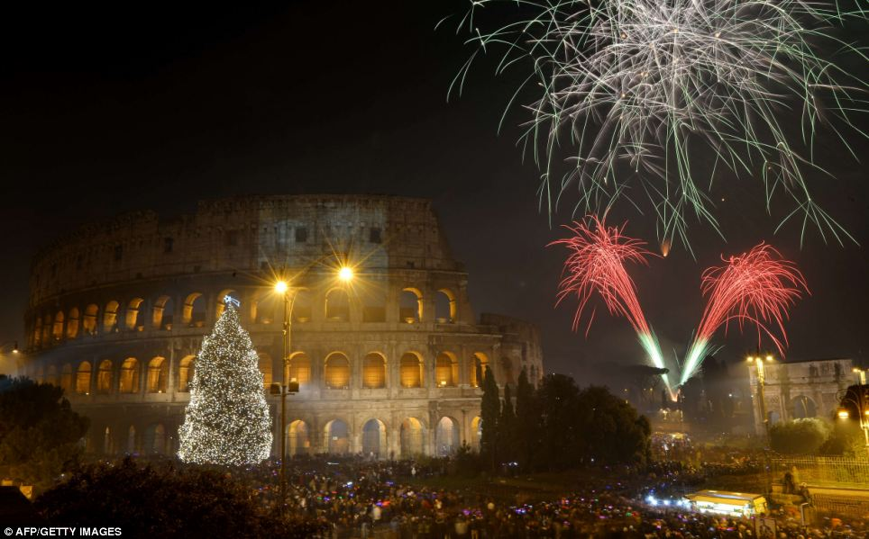 Fireworks light up the ancient Colisseum in central Rome's via dei Fori just after midnight