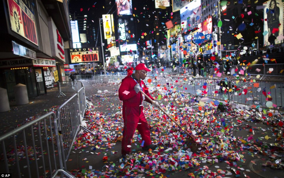 Happy New Year  America  Times Square revelers welcome 2013 with     Big job ahead  A worker clears confetti from a sidewalk in Times Square  after midnight