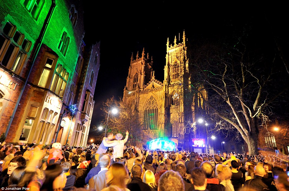 Gathering: Revellers welcome in the New Year in York, which had been affected by flooding over the festive period