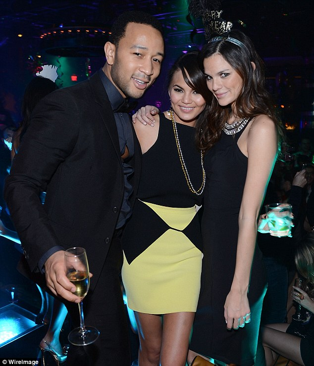 Having fun: John Legend and Chrissy Teigen toast the new year in style in Vegas