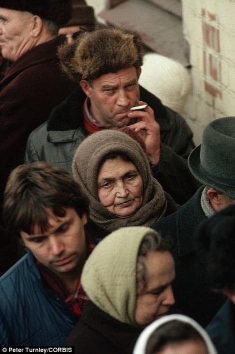 People Standing in bread line