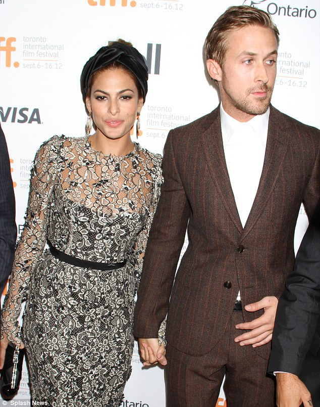 Playing dress up: Eva and Ryan held hands when they appeared at The Place Beyond the Pines premiere at the Toronto Film Festival on September 7