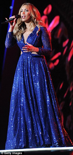 Glittering in the spotlight: Leona looked glamorous in the sparkling blue dress but the unflattering fit made her figure look larger than normal