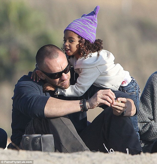 So cute: The toddler gives Martin a big hug