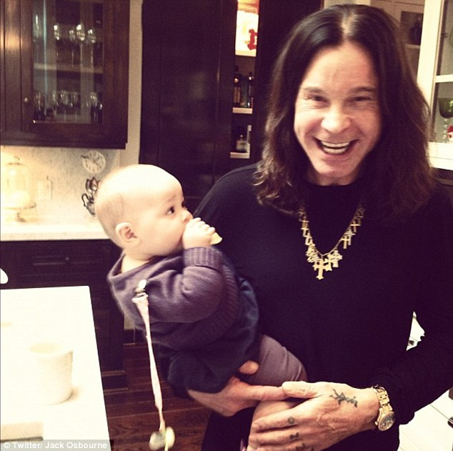 Family time: Ozzy Osbourne looked delighted as he held his granddaughter Pearl